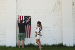 American Flag couples holding baby